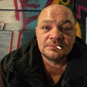 Modestas Primantas. Modistes has been in the UK for 18 years. Originally from Lithuania, he's worked full time as a builder for 16 of these years before his epilepsy became uncontrollable. He's been on the streets for two years. He has been told he's not entitled to benefits. He seems to feel as anonymous as the 7-digit hospital number on his wrist '2132232'